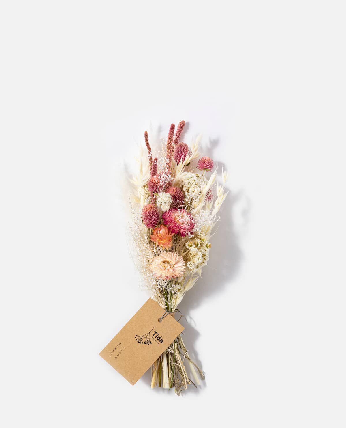 淡いピンク系ミニスワッグ(花材おまかせ)